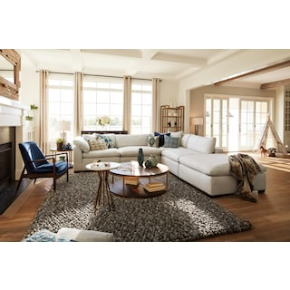 Plush 4-Piece Sectional and Ottoman - Anders Ivory