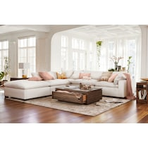 plush white  pc sectional and ottoman